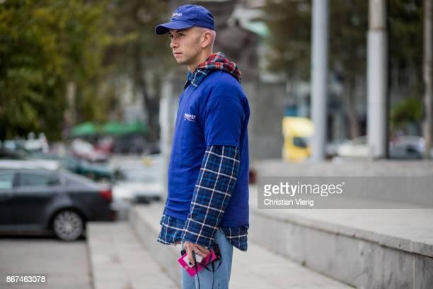 Ecce Homo wearing blue Balenciaga tshirt and cap is seen during Tbilisi Fashion Week Spring/Summer 2018 on October 28 2017 in Tbilisi Georgia