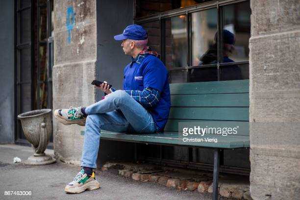 Ecce Homo wearing blue Balenciaga tshirt and cap sneakers is seen during Tbilisi Fashion Week Spring/Summer 2018 on October 28 2017 in Tbilisi Georgia