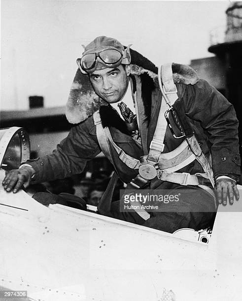 Eccentric American billionaire businessman Howard Hughes in the cockpit of the plane in which he set a record for speed, flying from Los Angeles,...