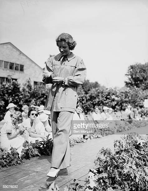 Eccentric American model and singer Edith Bouvier Beale walks a catwalk as she models a smock and matching pants outfit at the Easthampton Fair...