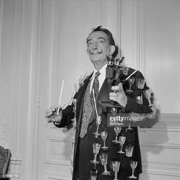 Eccentric artist Salvador Dali literally means what he says by 'the drinks are on me' At a press party held in Paris the wellknown artist wore a...