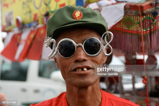 Eccentric Chinese like this man, who cycled thousands of kilometres from Yunnan in southwest China to be at the Olympic Games in Beijing, are...