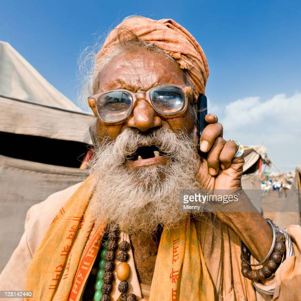 Eccentric Indian Senior Man using Mobile Phone