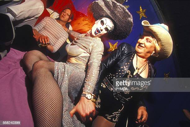 Eccentric looking clubbers at Bedrock at Heaven London Uk 2000s