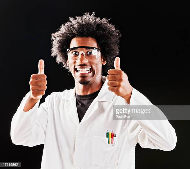 Eccentric scientist gives two approving thumbs up and grins