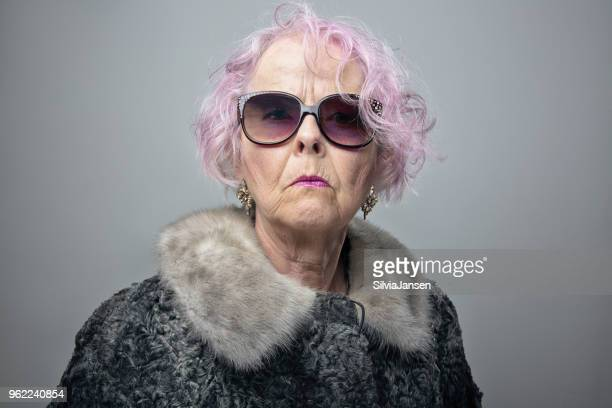 eccentric senior lady with cool attitude portrait - young at heart stock pictures, royalty-free photos & images