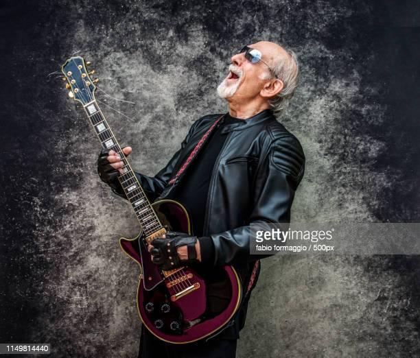 eccentric senior man portrait - heavy metal stock-fotos und bilder
