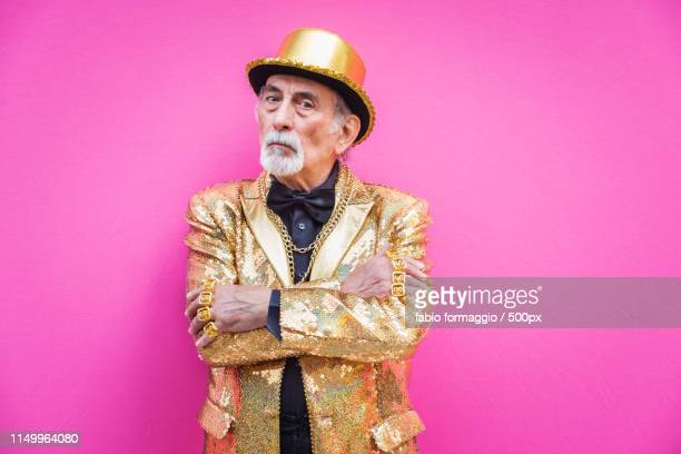 eccentric senior man portrait - gold jacket stock pictures, royalty-free photos & images