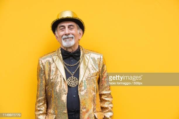 eccentric senior man portrait - gold jacket stock pictures, royalty-free photos & images