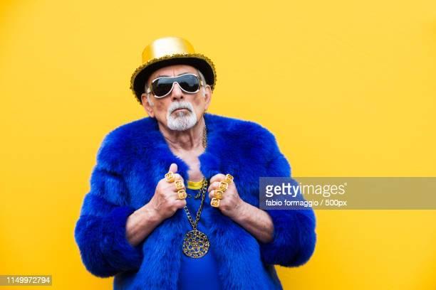 eccentric senior man portrait - caras raras fotografías e imágenes de stock