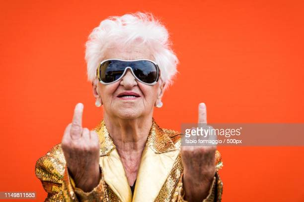 eccentric senior woman portrait - old lady middle finger stock pictures, royalty-free photos & images