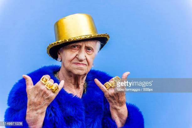 eccentric senior woman portrait - bling bling stock pictures, royalty-free photos & images