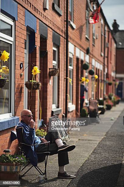 Eccles residents adorn their homes with yellow ribbons in support of Islamic State hostage Alan Henning on September 29 2014 in Salford England...