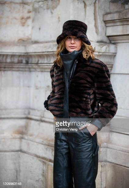 Ece Sukan is seen wearing brown jacket with animal print and bucket hat black leather pants outside Stella McCartney during Paris Fashion Week...