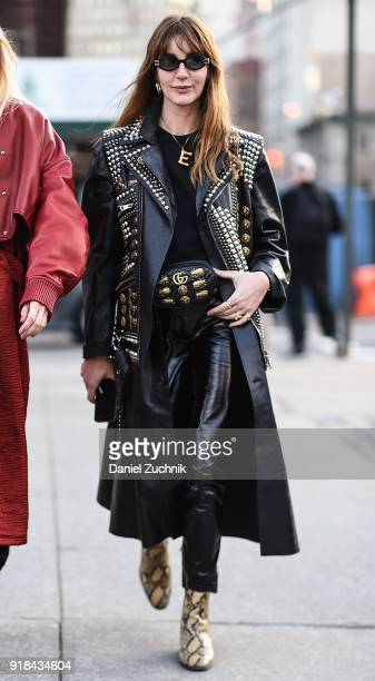 Ece Sukan is seen wearing Gucci leather coat and bag outside the Esteban Cortazar show during New York Fashion Week Women's A/W 2018 on February 14...