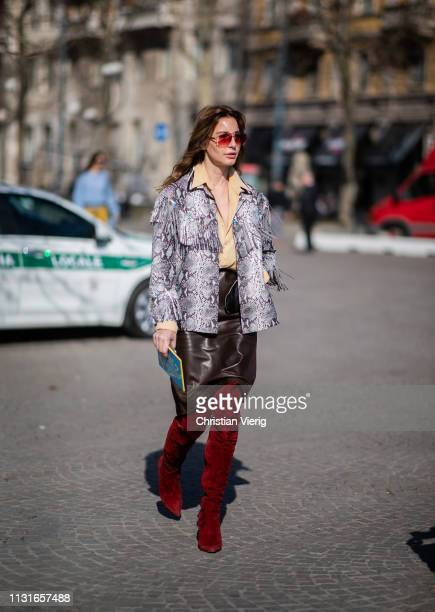 Ece Sukan is seen wearing jacket with snake print and fringes outside Bottega Veneta on Day 3 Milan Fashion Week Autumn/Winter 2019/20 on February...