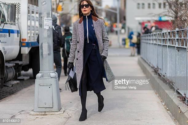 Ece Sukan is wearing a grey coat a blue seen outside Jason Wu during sportswear jacket and a blue skirt New York Fashion Week Women's Fall/Winter...