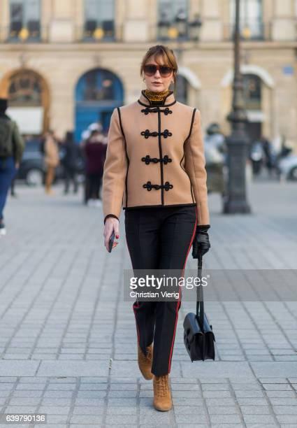 Ece Sukan wearing a beige jacket, black pants, outside Schiaparelli on January 23, 2017 in Paris, Canada.