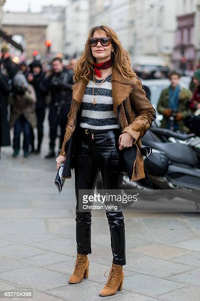 Ece Sukan wearing a brown fur jacket leather pants striped knit scarf outside Jean Paul Gaultier on January 25 2017 in Paris Canada