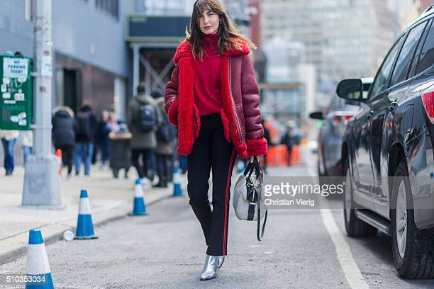 Ece Sukan wearing a red sweater and shearling leather jacket and silver boots seen outside Lacoste during New York Fashion Week Women's Fall/Winter...