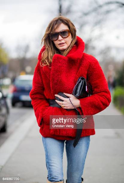 Ece Sukan wearing a red tedd coat with belt outside Chanel on March 7 2017 in Paris France