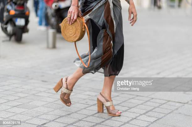 Ece Sukan wearing a round straw bag outside Schiaparelli during Paris Fashion Week Haute Couture Fall/Winter 20172018 Day Two on July 3 2017 in Paris...