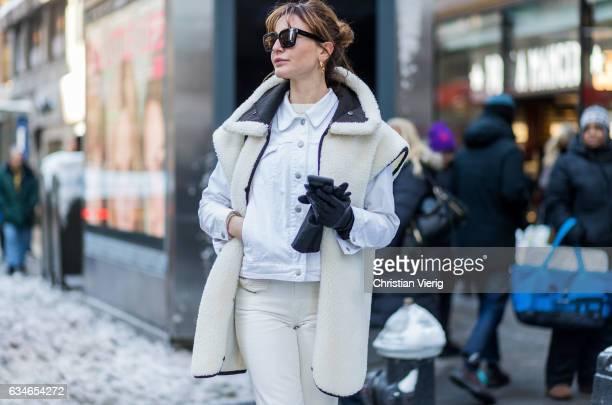Ece Sukan wearing a white sleeveless coat white jacket pants gloves outside Calvin Klein on February 10 2017 in New York City