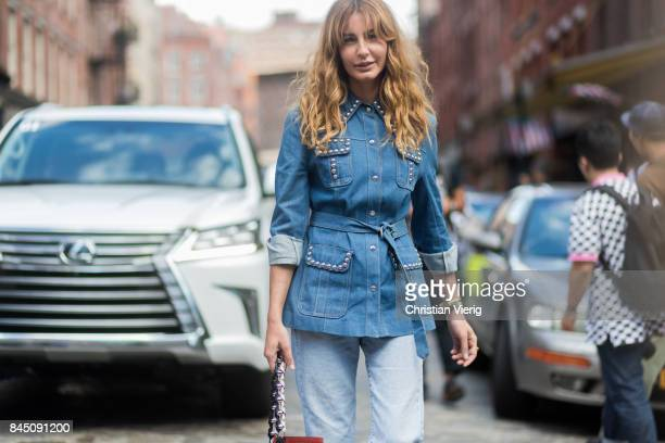 Ece Sukan wearing denim jacket in front of Lexus seen in the streets of Manhattan outside Tibi during New York Fashion Week on September 9 2017 in...