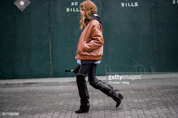 Ece Sukan wearing Supreme hoodie brown leather jacket plaid button shirt black overknees with fringes seen outside Tibi on February 11 2018 in New...