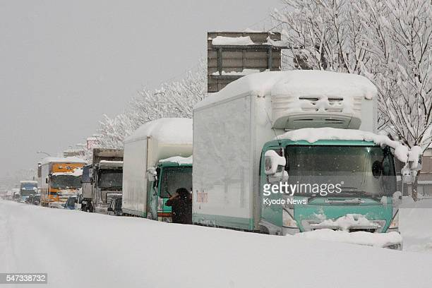 Echizen Japan Trucks are stranded due to heavy snow on a highway in Echizen Fukui Prefecture on Jan 31 2011