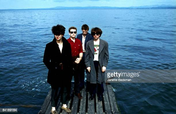 Echo and the Bunnymen standing near the water's edge 1981 L to R Ian McCulloch Les Pattinson Pete de Freitas and Will Sergeant Blackpool Great Britain