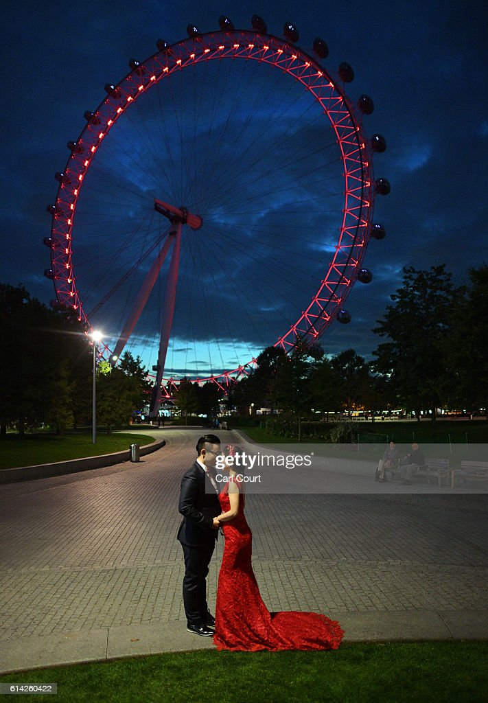 Echo Li and her fiance Charles Qian, pose during a pre-wedding photography shoot next to the London Eye on October 11, 2016 in London, England. It's a Chinese custom for couples to have their wedding photos taken before they are married and on the wedding day the photos will be shown to guests on cards and big screens. Photography studios such as J.R Studios in east London have seen business boom as the capital has become increasingly popular as a location for pre-wedding photography thanks in part to its instantly recognisable landmarks.
