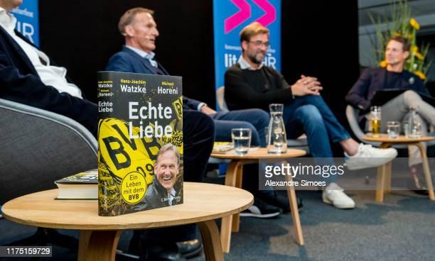 'Echte Liebe' Book Presentation with CEO HansJoachim Watzke author Michael Horeni Manager Juergen Klopp and host Alexander Bommes at Signal Iduna...
