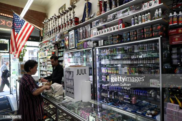 Cigarette vaporizer components and products are displayed at Smoke and Gift Shop on June 25 2019 in San Francisco California The San Francisco Board...
