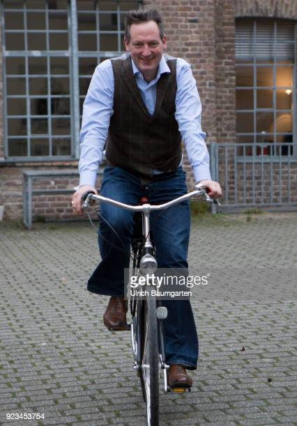 Eckaert von Hirschhausen german moderator doctor magician cabaret artist comedian and writer Hirschhausen on a bicycle on the the way to an interview