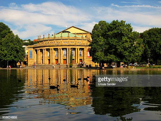 Eckensee with silhouettes of ducks and reflections of trees and the Wurttemberg State Theatres People sitting at the pond to relax tourists visit the...