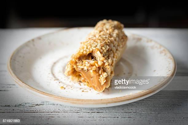 Eclair with dulce de leche filling