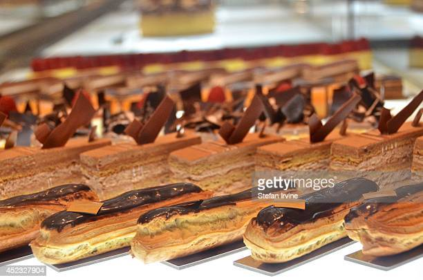 Eclairs and other pastries and cakes are displayed in a glass case on the counter at Island Gourmet a small coffee shop and patisserie at the Island...