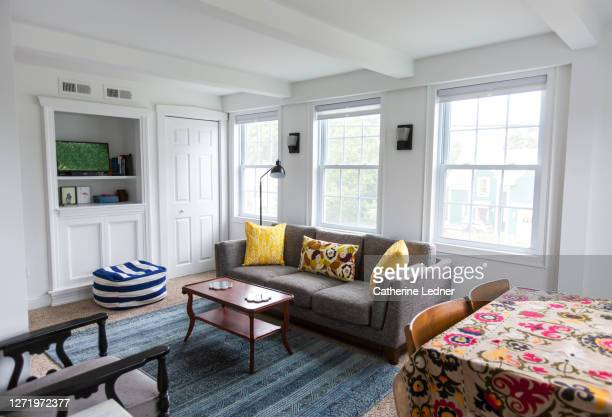 eclectic living room, clean and ready for new guests - catherine ledner stock pictures, royalty-free photos & images