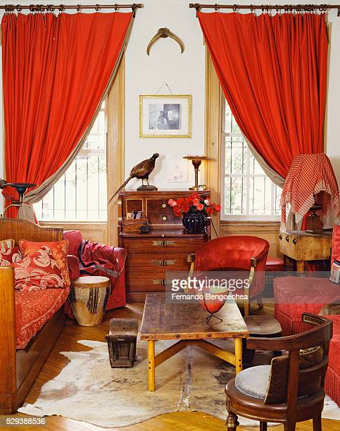 eclectic living room with red accents - fernando bengoechea stock pictures, royalty-free photos & images