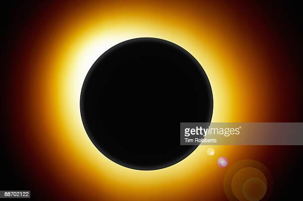 Eclipse with glowing sun behind globe