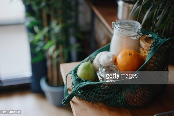 eco bag on kitchen counter with food in jars and fresh fruits. zero waste concept - sustainable resources stock pictures, royalty-free photos & images