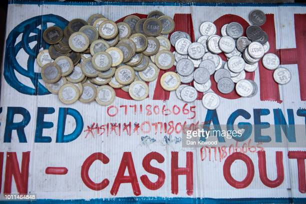 Eco Cash payments on a market on August 05 2018 in Harare Zimbabwe The import of second hand clothes into the informal sector in Zimbabwe has had a...