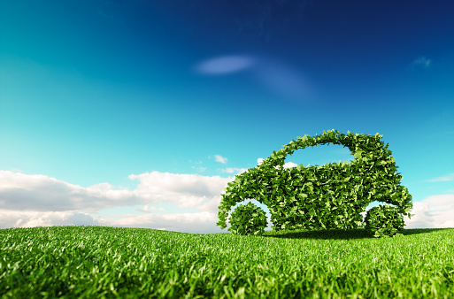 Eco friendly car development, clear ecology driving, no pollution and emmission transportation concept. 3d rendering of green car icon on fresh spring meadow with blue sky in background. 961421364