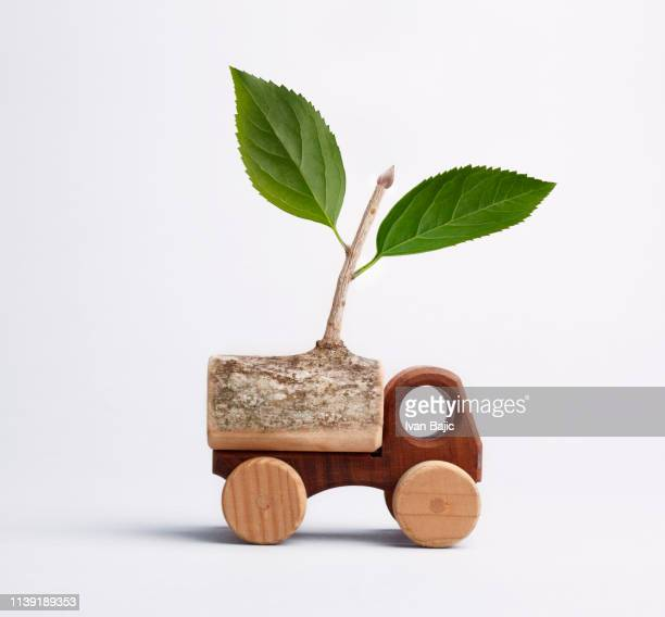 eco friendly transportation concept - hybrid vehicle stock photos and pictures