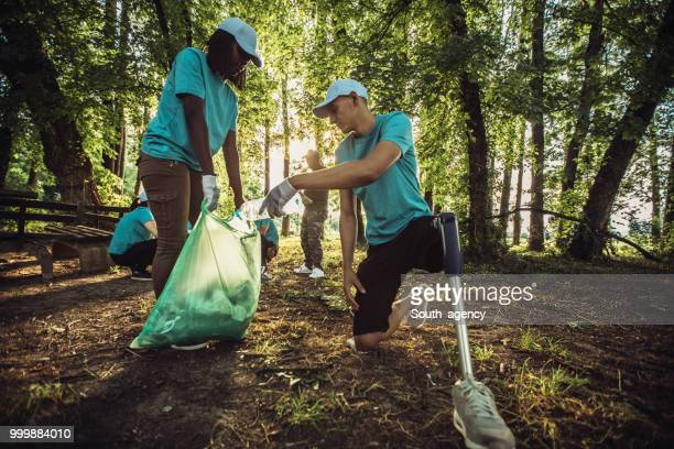 eco volunteering - disability collection stock pictures, royalty-free photos & images