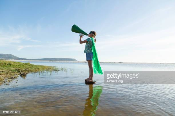 eco warrior superhero shouting into megaphone - climate activist stock pictures, royalty-free photos & images