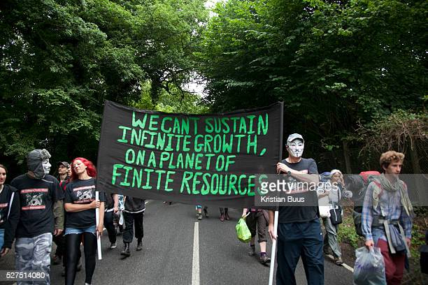Eco-activists walk down London Road to join the 'Reclaim the Power' camp on the day of the swoop. The camp is set up in a field in solidarity with...