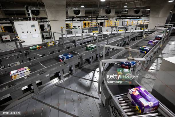 Eco-bags carrying fresh food move along a conveyor belt at a Coupang Corp. Fulfillment center in Bucheon, South Korea, on Friday, Feb. 19, 2021....