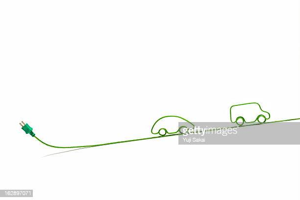 eco-car shaped   electric cord - electric car stock photos and pictures